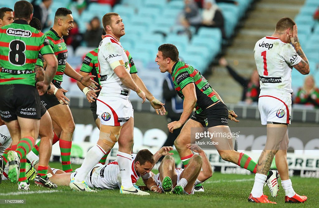 <a gi-track='captionPersonalityLinkClicked' href=/galleries/search?phrase=Sam+Burgess&family=editorial&specificpeople=2650353 ng-click='$event.stopPropagation()'>Sam Burgess</a> of the Rabbitohs celebrates scoring a try during the round 19 NRL match between the South Sydney Rabbitohs and the St George Illawarra Dragons at ANZ Stadium on July 22, 2013 in Sydney, Australia.
