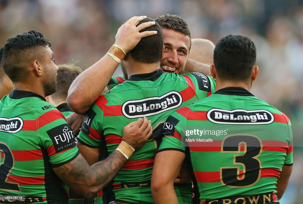 <a gi-track='captionPersonalityLinkClicked' href=/galleries/search?phrase=Sam+Burgess&family=editorial&specificpeople=2650353 ng-click='$event.stopPropagation()'>Sam Burgess</a> of the Rabbitohs celebrates with team mates after scoring a try during the round seven NRL match between the South Sydney Rabbitohs and the Canterbury-Bankstown Bulldogs at ANZ Stadium on April 18, 2014 in Sydney, Australia.