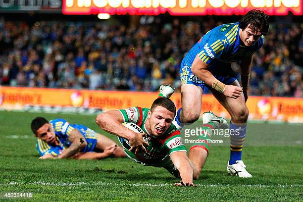 Sam Burgess of the Rabbitohs dives over the line to score a try during the round 19 NRL match between the Parramatta Eels and the South Sydney...