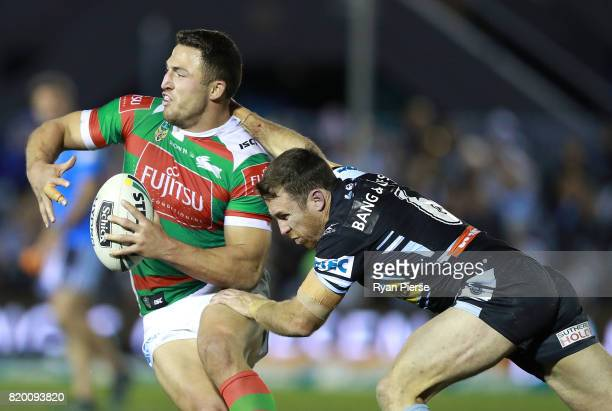 Sam Burgess of the Rabbitohs is tackled by James Maloney of the Sharks during the round 20 NRL match between the Cronulla Sharks and the South Sydney...