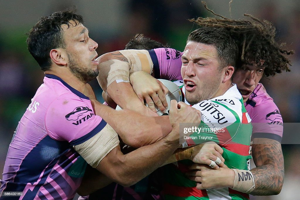 Sam Burgess of the Rabbitohs is tackled during the round 22 NRL match between the Melbourne Storm and the South Sydney Rabbitohs at AAMI Park on...
