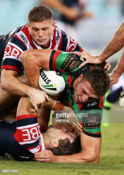 Sam Burgess of the Rabbitohs is tackled during the round four NRL match between the South Sydney Rabbitohs and the Sydney Roosters at ANZ Stadium on...