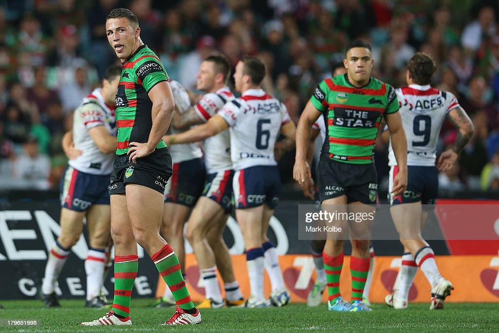 Sam Burgess of the Rabbitohs looks dejected after a Roosters try during the round 26 NRL match between the South Sydney Rabbitohs and the Sydney Roosters at ANZ Stadium on September 6, 2013 in Sydney, Australia.