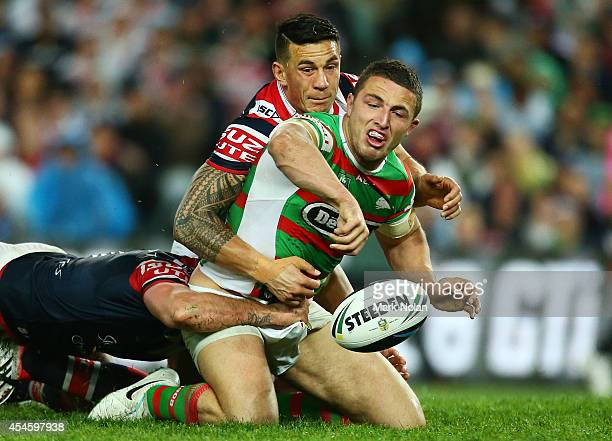 Sam Burgess of the Rabbitohs loses the ball in a tackle by Sonny Bill Williams of the Roosters during the round 26 NRL match between the Sydney...