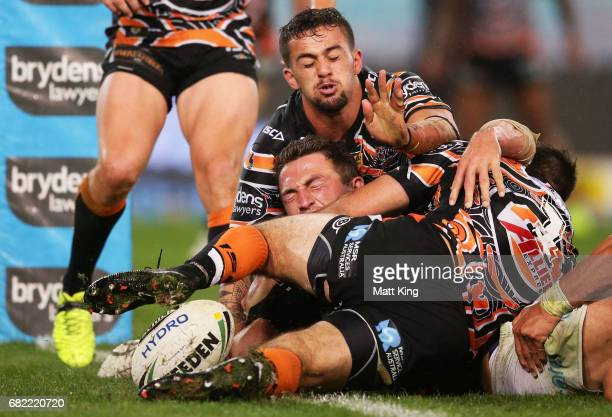 Sam Burgess of the Rabbitohs reaches out to score his second try during the round ten NRL match between the Wests Tigers and the South Sydney...