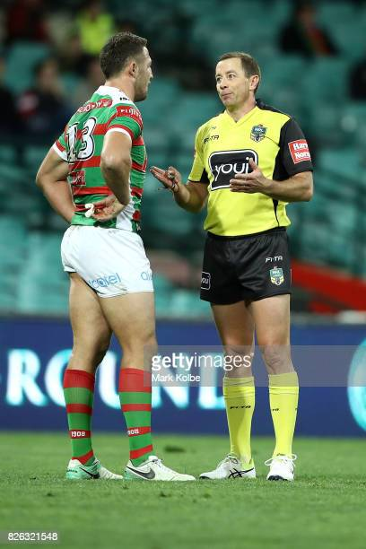 Sam Burgess of the Rabbitohs speaks to referee Ben Cummins during the round 22 NRL match between the St George Illawarra Dragons and the South Sydney...