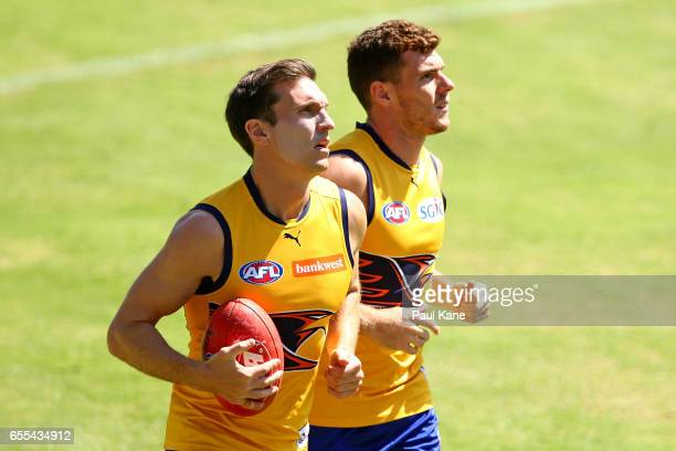 Sam Butler and Luke Shuey of the Eagles jog laps during a West Coast Eagles AFL training session at Domain Stadium on March 20 2017 in Perth Australia