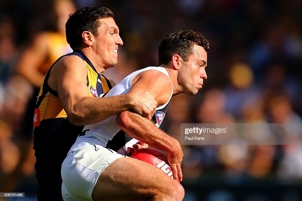Sam Butler of the Eagles tackles Jarryd Blair of the Magpies during the round six AFL match between the West Coast Eagles and the Collingwood Magpies at Domain Stadium on May 1, 2016 in Perth, Australia.