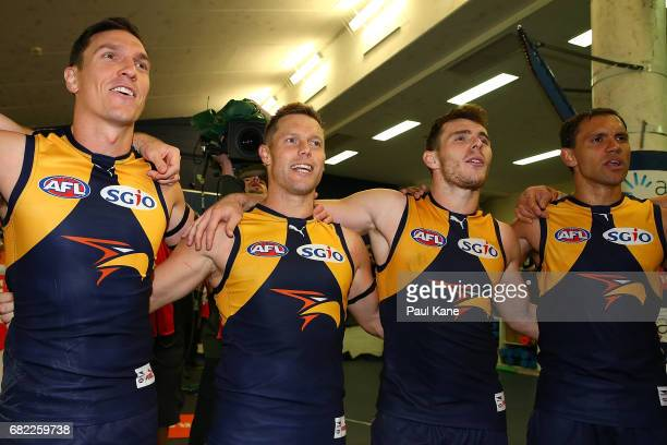 Sam Butler Sam Mitchell Luke Shuey and Josh Hill of the Eagles sing the club song after winning the round eight AFL match between the West Coast...