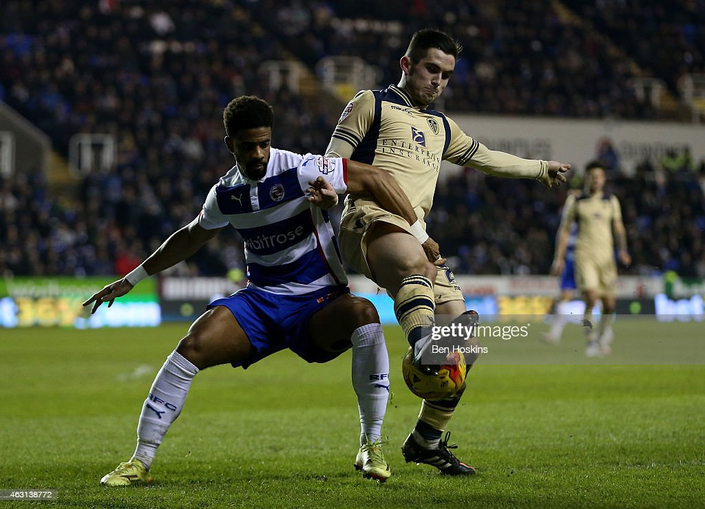 Sam Byram of Leeds and Garath McCleary of Reading battle for possession during the Sky Bet Championship match between Reading and Leeds United at Madejski Stadium on February 10, 2015 in Reading, England.