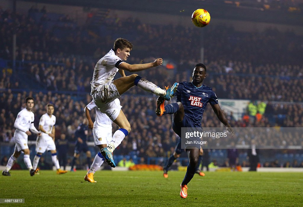 Sam Byram of Leeds clears the ball from Simon Dawkins of Derby County during the Sky Bet Championship match between Leeds United and Derby County at Elland Road on November 29, 2014 in Leeds, England.