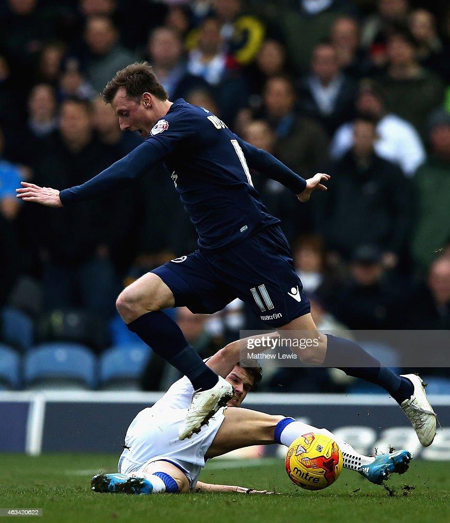 Sam Byram of Leeds United tackles Martyn Woolford of Millwall during the Sky Bet Championship match between Leeds United and Millwall at Elland Road on February 14, 2015 in Leeds, England.
