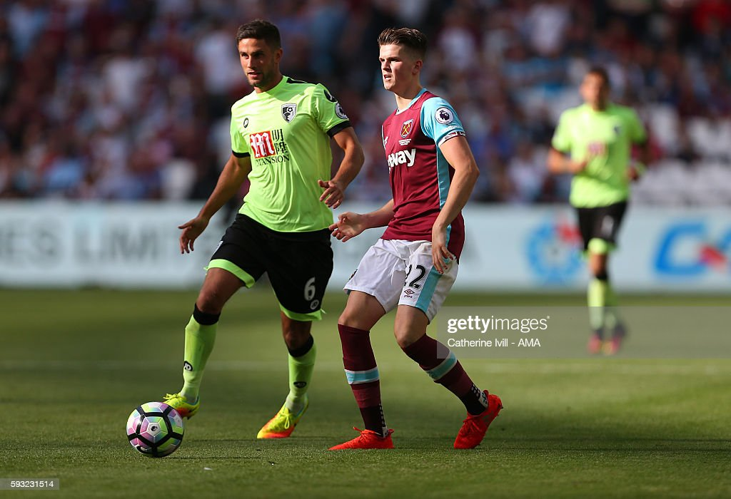 Sam Byram of West Ham in action with Andrew Surman of Bournemouth during the Premier League match between West Ham United and AFC Bournemouth at Olympic Stadium on August 21, 2016 in London, England.
