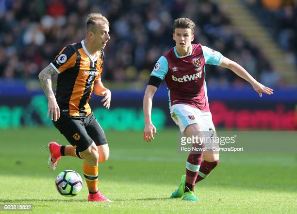 Sam Byram of West Ham United and Hull City's Kamil Grosicki during the Premier League match between Hull City and West Ham United at KCOM Stadium on...