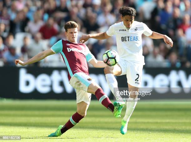 Sam Byram of West Ham United and Jefferson Montero of Swansea City battle for possession during the Premier League match between West Ham United and...