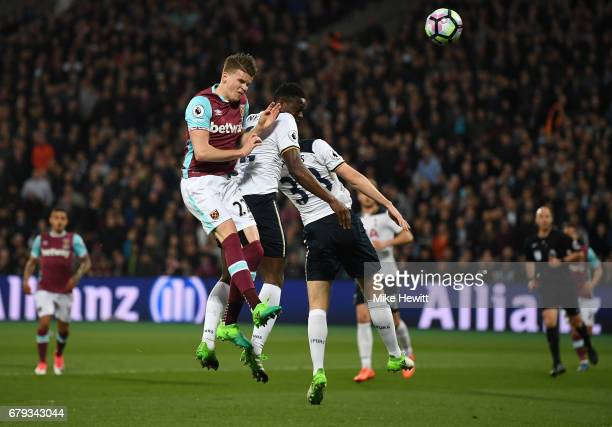 Sam Byram of West Ham United and Victor Wanyama of Tottenham Hotspur compete for a header during the Premier League match between West Ham United and...