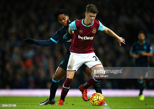 Sam Byram of West Ham United holds off Raheem Sterling of Manchester City during the Barclays Premier League match between West Ham United and...