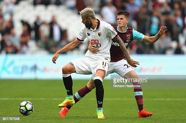 Sam Byram of West Ham United holds onto Valon Behrami of Watford during the Premier League match between West Ham United and Watford at Olympic...