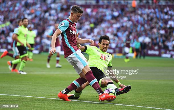 Sam Byram of West Ham United is tackled by Charlie Daniels of AFC Bournemouth during the Premier League match between West Ham United and AFC...