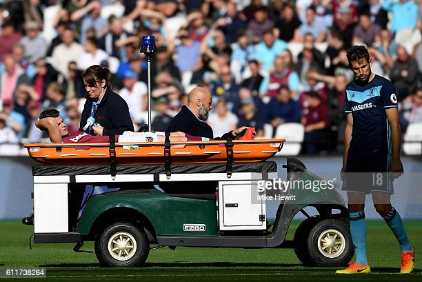 Sam Byram of West Ham United is taken off injured on a stretcher during the Premier League match between West Ham United and Middlesbrough at London...