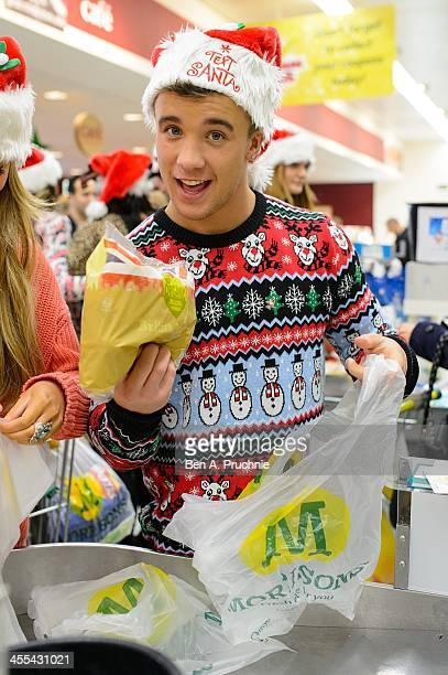 Sam Callahan participates during the Text Santa Celebrity Bag Pack at Morrisons on December 12 2013 in London England
