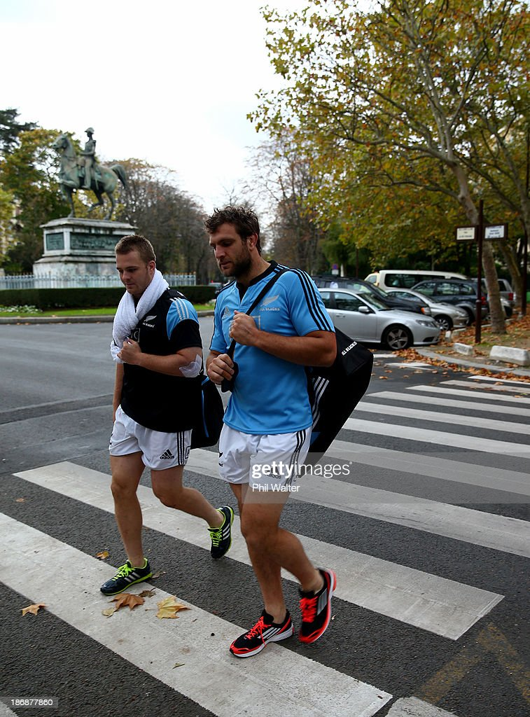Sam Cane (L) and Luke Whitelock (R) of the New Zealand All Blacks walk back from a pool recovery session on November 4, 2013 in Paris, France.
