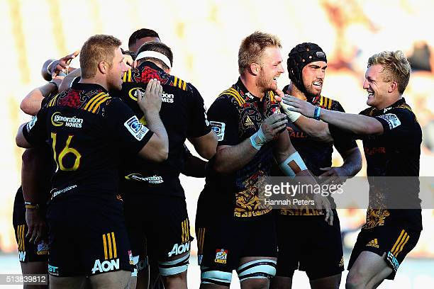 Sam Cane of the Chiefs and Damian McKenzie of the Chiefs celebrate after James Lowe of the Chiefs scored a try during the round two Super Rugby match...