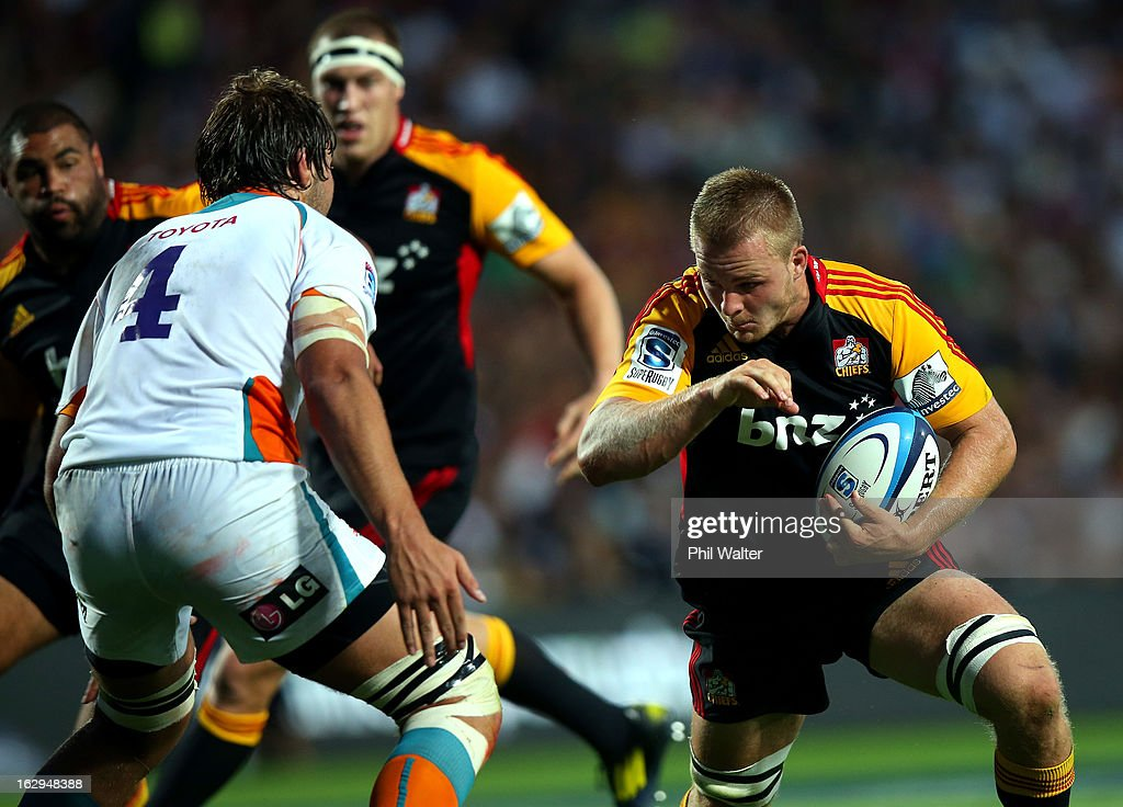 Sam Cane of the Chiefs fends off Lodewyk De Jager of the Cheetahs during the round three Super Rugby match between the Chiefs and the Cheetahs at Waikato Stadium on March 2, 2013 in Hamilton, New Zealand.