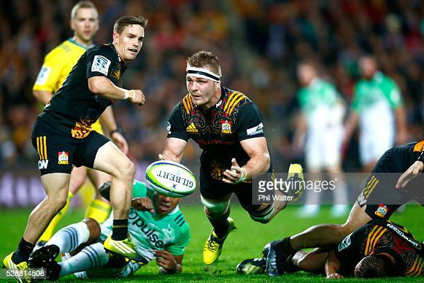 Sam Cane of the Chiefs passes the ball during the round 11 Super Rugby match between the Chiefs and the Highlanders on May 7 2016 in Hamilton New...
