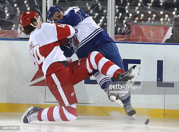 DETROIT MI DECEMBER 30 Sam Carrick is tied up by Brennan Evans as the Toronto Marlies beat the Grand Rapid Griffins in a shootout in the outside game...