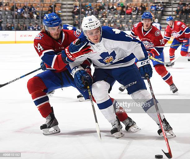 Sam Carrick of the Toronto Marlies controls the puck against Brett Lernout of the St John's IceCaps during AHL game action November 28 2015 at Air...