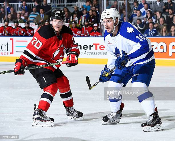 Sam Carrick of the Toronto Marlies watches the play develop against Brian O'Neill of the Albany Devils during AHL playoff game action May 6 2016 at...