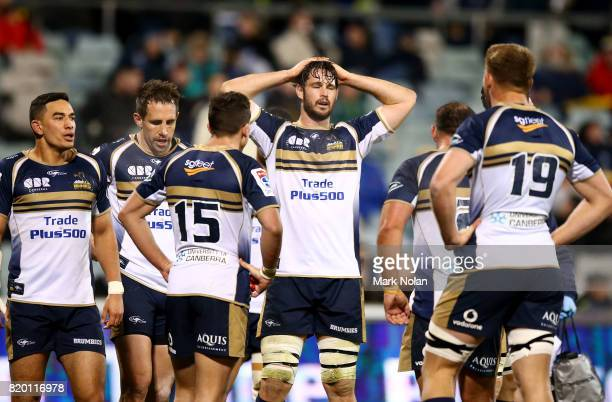 Sam Carter of the Brumbies and team mates look dejected during the Super Rugby Quarter Final match between the Brumbies and the Hurricanes at...
