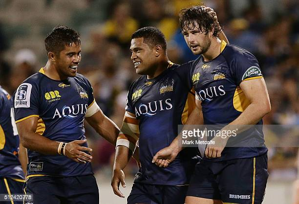 Sam Carter of the Brumbies celebrates scoring a try with team mates during the round one Super Rugby match between the Brumbies and the Hurricanes at...