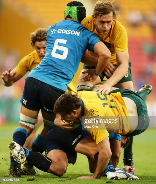 Sam Carter of the Wallabies is tackled as Ned Hanigan of the Wallabies supports during the International Test match between the Australian Wallabies...