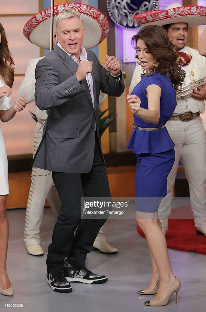 Sam Champion and Alessandra Rosaldo are seen on the set of Despierta America for simulcast with 'Good Morning America' and Fusion's the Morning Show' at Univision Headquarters on October 28, 2013 in Miami, Florida.