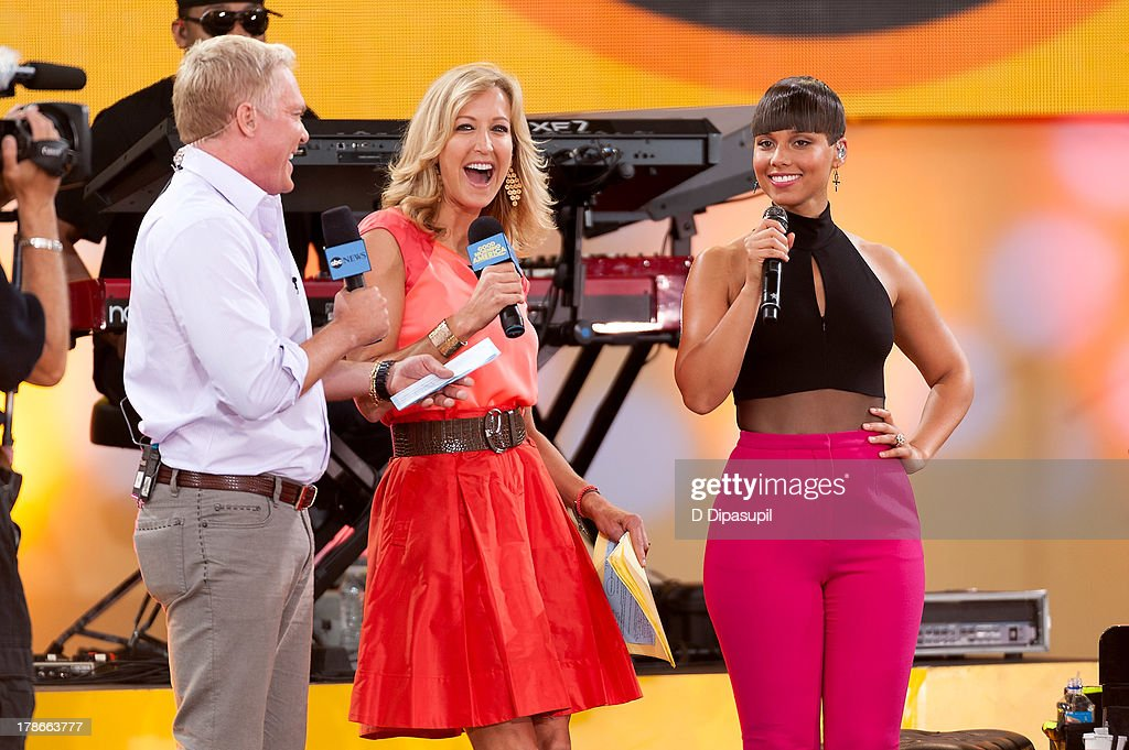 Sam Champion and Lara Spencer interview Alicia Keys on ABC's 'Good Morning America' at Rumsey Playfield on August 30, 2013 in New York City.