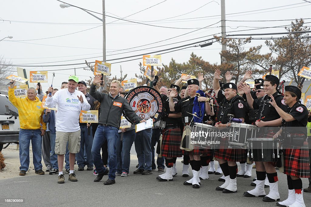 AMERICA - Sam Champion and the GMA team surprise volunteers at the Breezy Point, NY Fire Department, which sustained damage during Hurricane Sandy, with donations to build a higher structure, on GOOD MORNING AMERICA, 5/7/13, airing on the ABC Television Network. Donations were provided by the Graybeards, Habitat for Humanity and many other organizations. The Bergen County Firefighters Pipe Band from New Jersey led the parade to the firehouse. (Photo by Ida Mae Astute/ABC via Getty Images) SAM