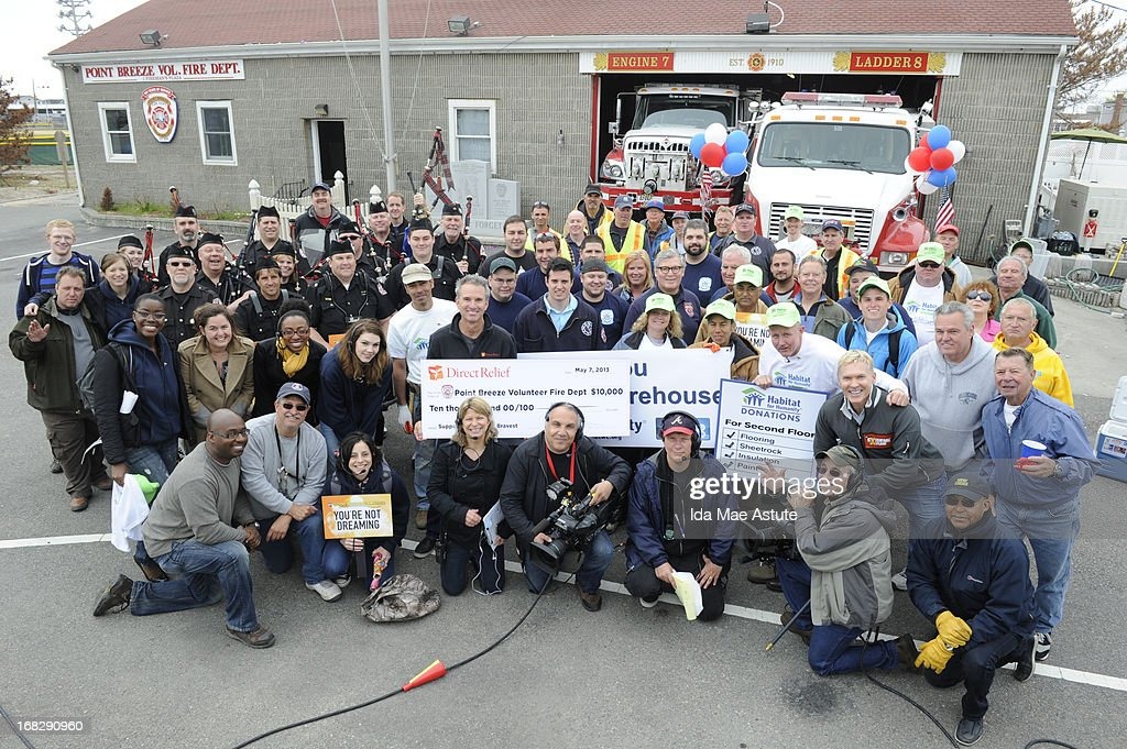 AMERICA - Sam Champion and the GMA team surprise volunteers at the Breezy Point, NY Fire Department, which sustained damage during Hurricane Sandy, with donations to build a higher structure, on GOOD MORNING AMERICA, 5/7/13, airing on the ABC Television Network. Donations were provided by the Graybeards, Habitat for Humanity and many other organizations. The Bergen County Firefighters Pipe Band from New Jersey led the parade to the firehouse. (Photo by Ida Mae Astute/ABC via Getty Images) SAM CHAMPION, VOLUNTEERS