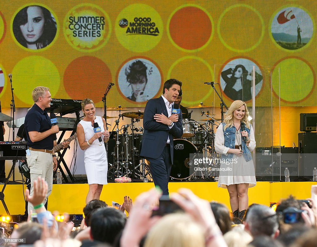 Sam Champion, Ginger Zee, Josh Elliott and singer-songwriter Demi Lavato on stage during ABC's 'Good Morning America' at Rumsey Playfield on June 28, 2013 in New York City.