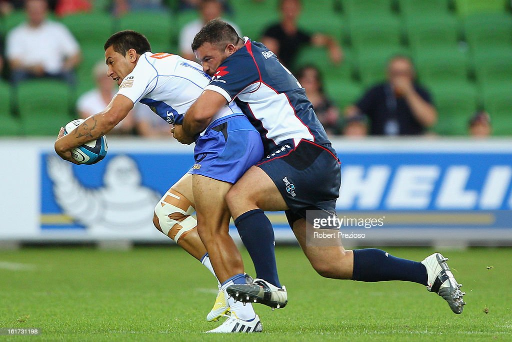 Sam Christie of the Force is tackled by Laurie Weeks of the Rebels during the round one Super Rugby match between the Rebels and the Force at AAMI Park on February 15, 2013 in Melbourne, Australia.
