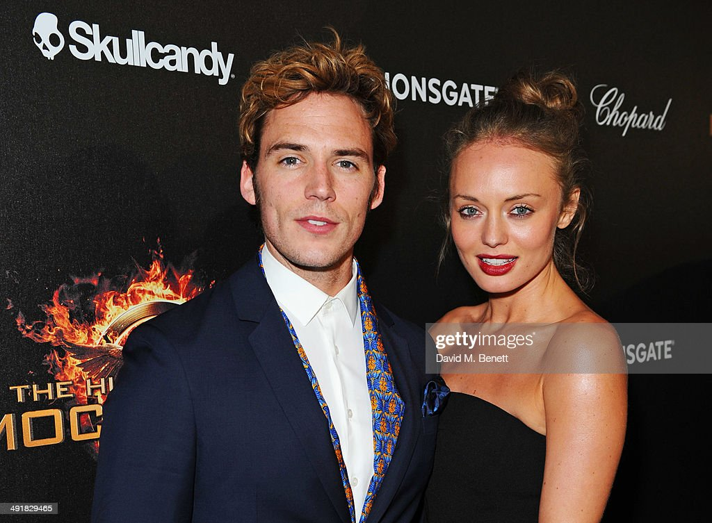 Sam Claflin (L) and Laura Haddock attend Lionsgate's 'The Hunger Games: Mockingjay Part 1' party at a private villa on May 17, 2014 in Cannes, France.