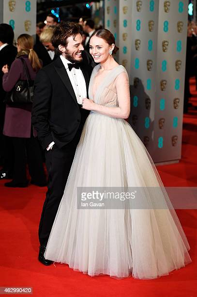 Sam Claflin and Laura Haddock attend the EE British Academy Film Awards at The Royal Opera House on February 8 2015 in London England