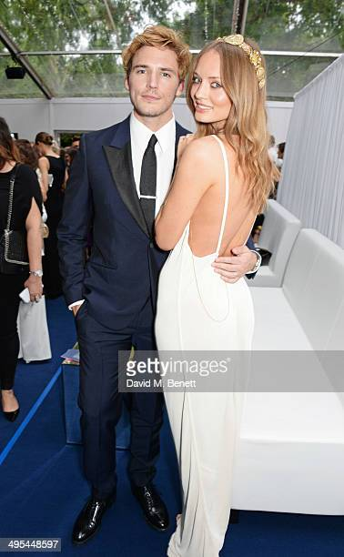 Sam Claflin and Laura Haddock attend the Glamour Women of the Year Awards in Berkeley Square Gardens on June 3 2014 in London England