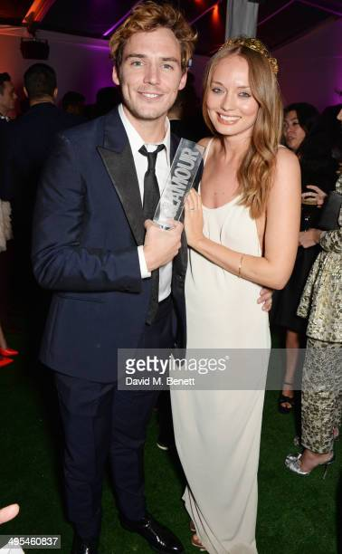 Sam Claflin and Laura Haddock attend the Glamour Women of the Year Awards after party in Berkeley Square Gardens on June 3 2014 in London England
