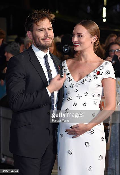 Sam Claflin and Laura Haddock attend The Hunger Games Mockingjay Part 2 UK Premiere at Odeon Leicester Square on November 5 2015 in London England