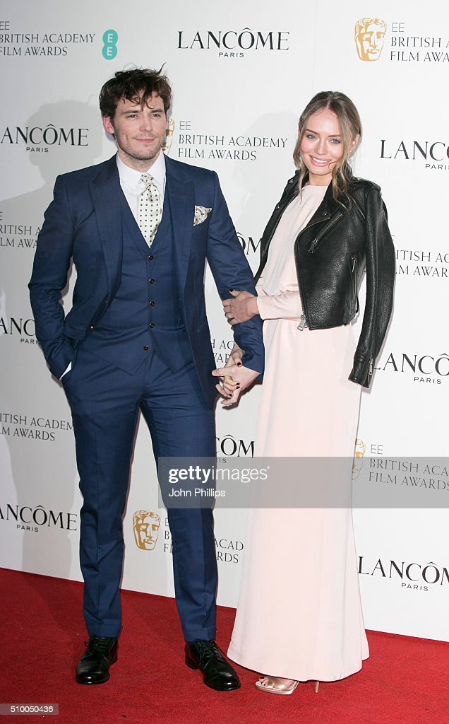 Sam Claflin and Laura Haddock attend the Lancome BAFTA nominees party at Kensington Palace on February 13, 2016 in London, England.