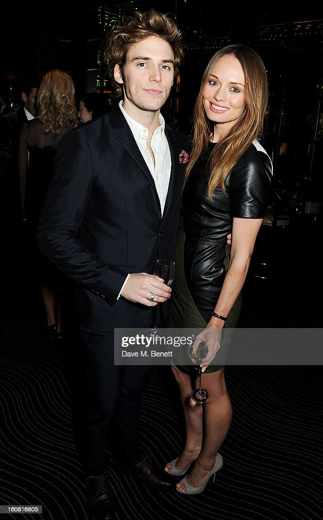 Sam Claflin (L) and Laura Haddock attend the Pre-BAFTA Party hosted by EE and Esquire ahead of the 2013 EE British Academy Film Awards at The Savoy Hotel on February 6, 2013 in London, England.