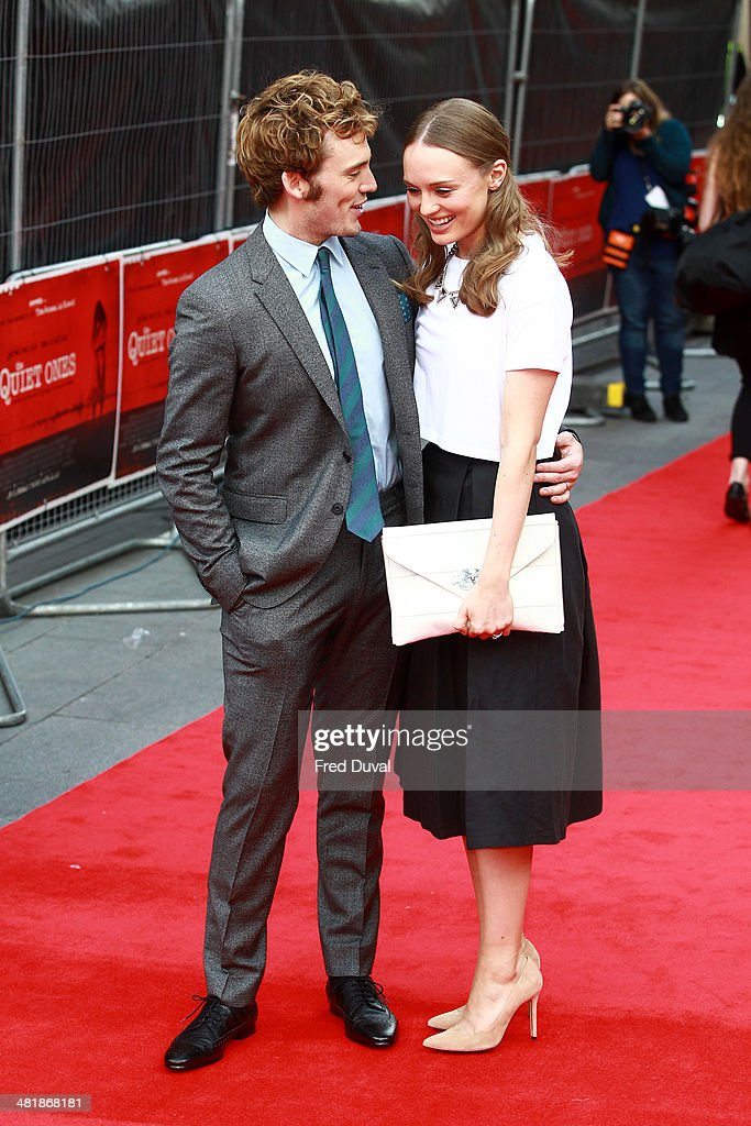 <a gi-track='captionPersonalityLinkClicked' href=/galleries/search?phrase=Sam+Claflin&family=editorial&specificpeople=7238693 ng-click='$event.stopPropagation()'>Sam Claflin</a> and <a gi-track='captionPersonalityLinkClicked' href=/galleries/search?phrase=Laura+Haddock&family=editorial&specificpeople=4949007 ng-click='$event.stopPropagation()'>Laura Haddock</a> attend the UK film premiere of 'The Quiet Ones' at Odeon West End on April 1, 2014 in London, England.