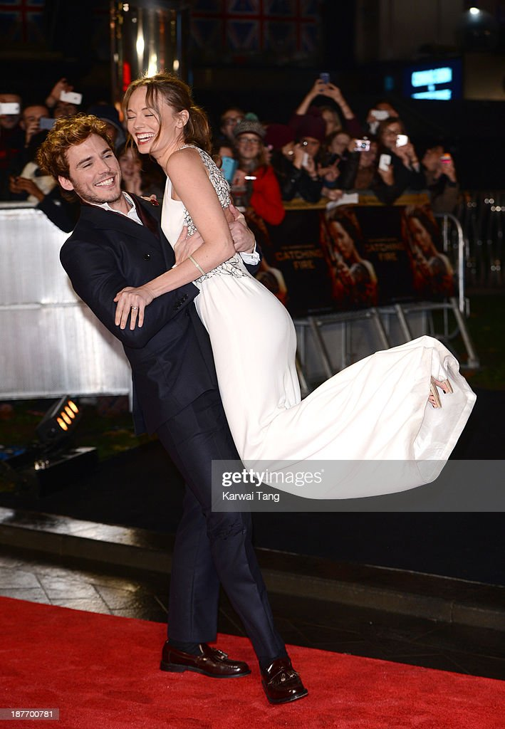 <a gi-track='captionPersonalityLinkClicked' href=/galleries/search?phrase=Sam+Claflin&family=editorial&specificpeople=7238693 ng-click='$event.stopPropagation()'>Sam Claflin</a> and <a gi-track='captionPersonalityLinkClicked' href=/galleries/search?phrase=Laura+Haddock&family=editorial&specificpeople=4949007 ng-click='$event.stopPropagation()'>Laura Haddock</a> attend the UK Premiere of 'The Hunger Games: Catching Fire' at Odeon Leicester Square on November 11, 2013 in London, England.